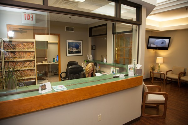 dental receptionist at desk