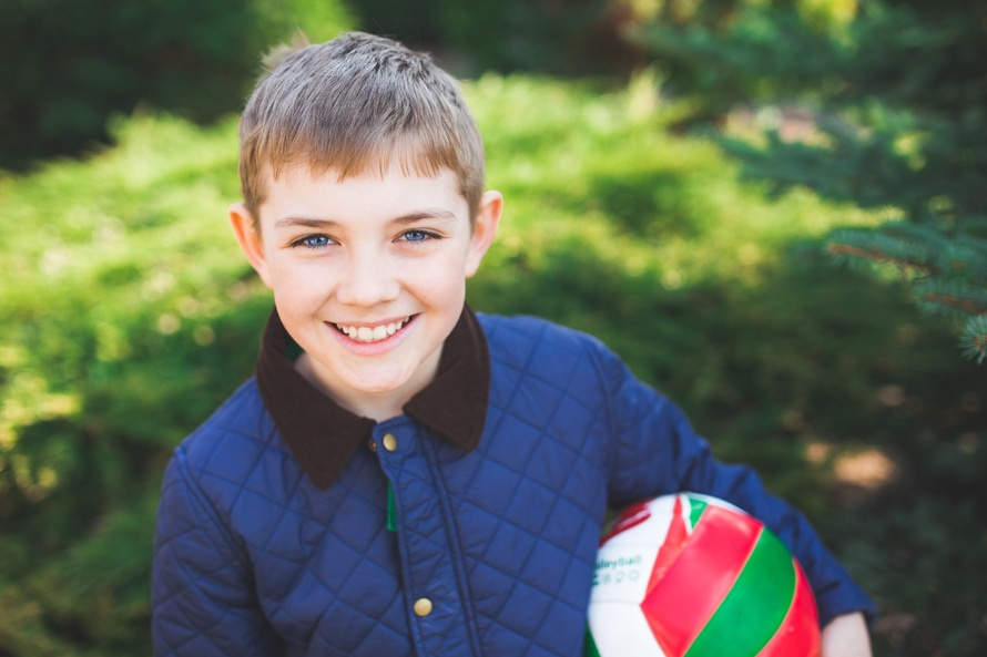 boy with ball smilling